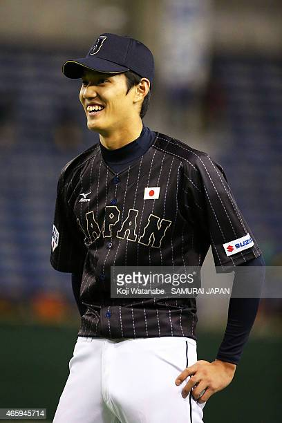 Shintaro Fujinami of Samurai Japan looks on during the Samurai Japan v All Euro match at the Tokyo Dome on March 11 2015 in Tokyo Japan