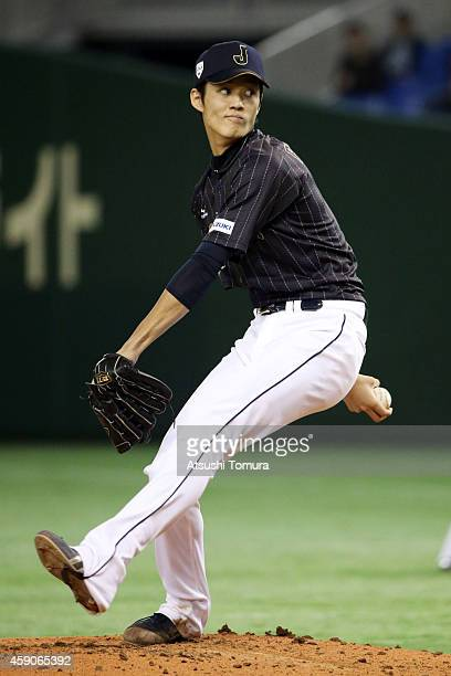 Shintaro Fujinami of Samurai Japan pitches in the first inning during the game four of Samurai Japan and MLB All Stars at Tokyo Dome on November 16...