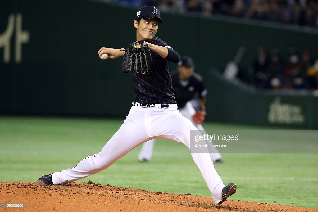 Shintaro Fujinami #17 of Samurai Japan pitches in the first inning during the game four of Samurai Japan and MLB All Stars at Tokyo Dome on November 16, 2014 in Tokyo, Japan.