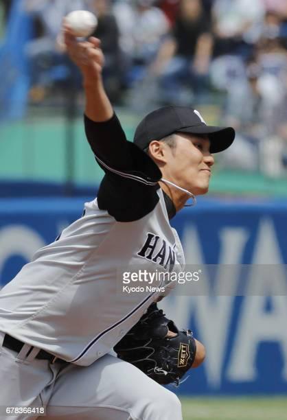 Shintaro Fujinami of the Hanshin Tigers pitches against the Yakult Swallows at Jingu Stadium in Tokyo on May 4 2017 Fujinami allowed one run in 71/3...