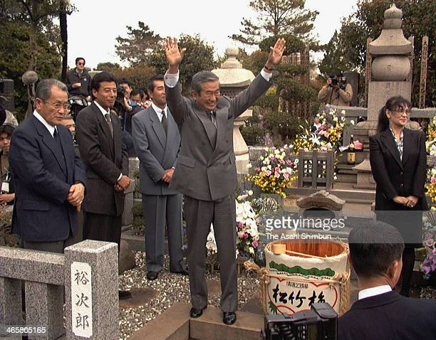 Shintaro Ishihara visits the grave of brother and actor Yujiro Ishihara after being elected as Governor of Tokyo on April 12 1999 in Yokohama...