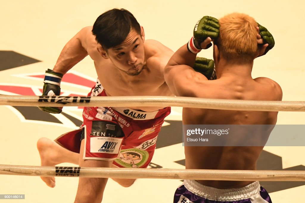 Shintaro Ishiwatari of Japan punches Takafumi Otsuka of Japan in the bantam weight GP semi-final bout during the RIZIN Fighting World Grand-Prix 2017 final Round at Saitama Super Arena on December 31, 2017 in Saitama, Japan.