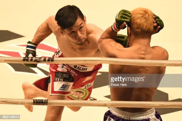 Shintaro Ishiwatari of Japan punches Takafumi Otsuka of Japan in the bantam weight GP semifinal bout during the RIZIN Fighting World GrandPrix 2017...