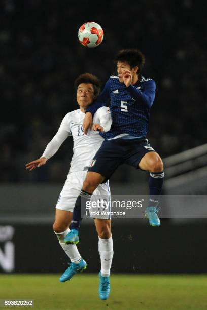 Shintaro Kurumaya of Japan and Yeom Kihun of South Korea compete for the ball during the EAFF E1 Men's Football Championship between Japan and South...
