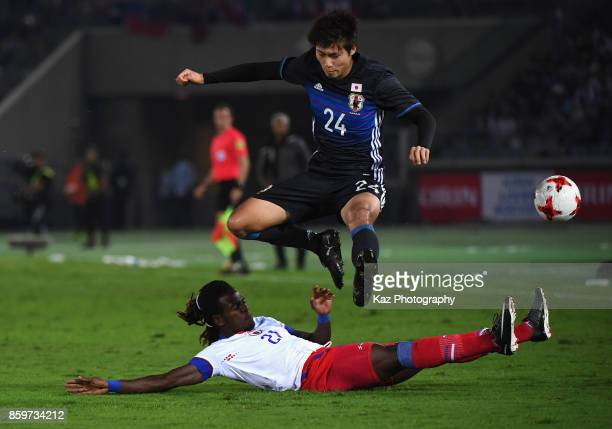 Shintaro Kurumaya of Japan is tackled by Samuel Maedochee Pompe of Haiti during the international friendly match between Japan and Haiti at Nissan...