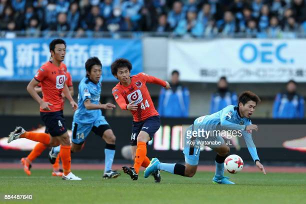 Shintaro Kurumaya of Kawasaki Frontale is fouled by Yusuke Segawa of Omiya Ardija resulting in a penalty kick during the JLeague J1 match between...