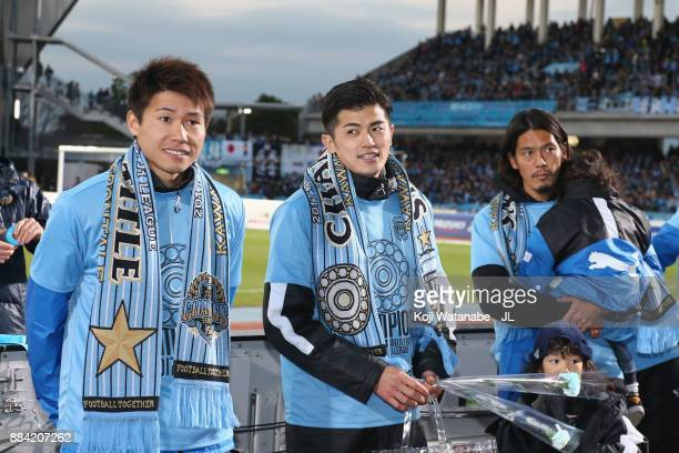 Shintaro Kurumaya Shogo Taniguchi and Yusuke Igawa of Kawasaki Frontale celebrate the JLeague Champions with supporters after the JLeague J1 match...