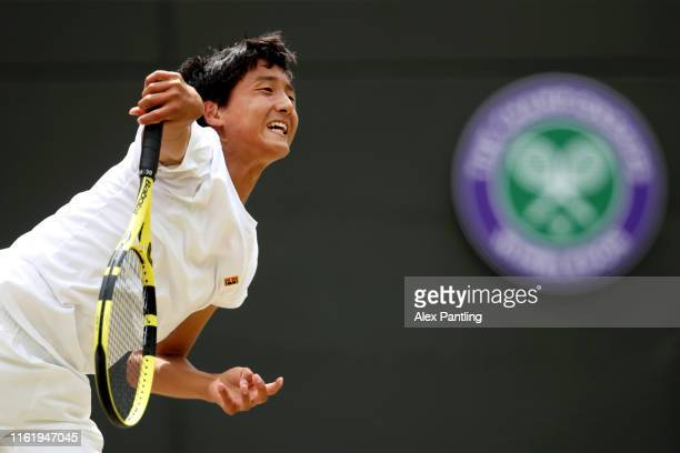 Shintaro Mochizuki of Japan serves in his Boys' Singles Final match against Carlos Gimeno Valero of Spain during Day thirteen of The Championships -...