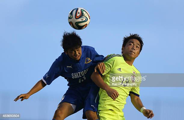 Shintaro Nago of Shizuoka Selection and Daisuke Takagi of Japan compete for the ball during the SBS Cup International Your Soccer match between Japan...