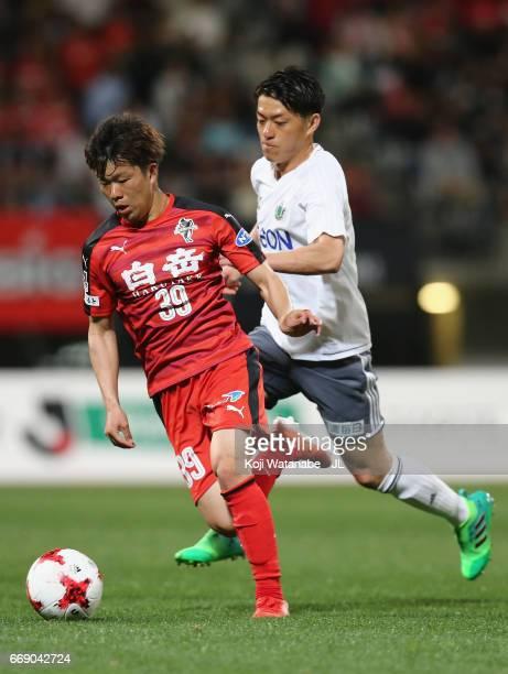 Shintaro Shimada of Roasso Kumamoto and Hayuma Tanaka of Matsumoto Yamaga during the JLeague J2 match between Roasso Kumamoto and Matsumoto Yamaga at...