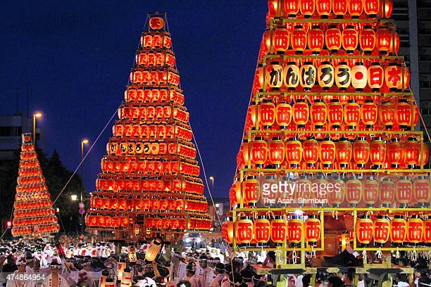 Shinto parishioners carry 10metertall 25ton 'Chochin O Yamagasa' or candlelit lantern floats during the Tobata Gion Yamagasa Festival on May 22 2011...