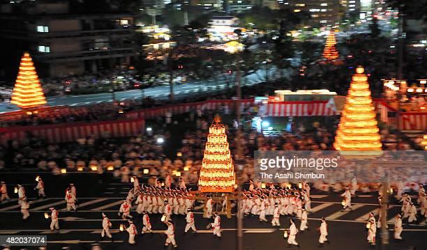Shinto parishioners carry 10metertall 25ton 'Chochin O Yamagasa' or candlelit lantern floats during the Tobata Gion Yamagasa Festival on July 25 2015...