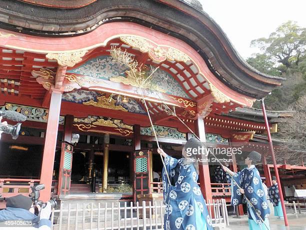 Shinto priest and shrine maiden clean the main hall during the annual dusting at Dazaifu Tenmangu Shrine on December 20 2013 in Dazaifu Fukuoka Japan