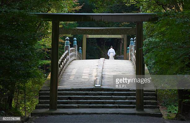 Shinto Priest and Wooden Bridge at Ise Jingu Shrine in Mie Prefecture, Japan