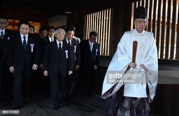 Shinto priest leads Japanese lawmakers visiting the controversial Yasukuni shrine in Tokyo on December 5 2017 Dozens of Japanese parliament members...