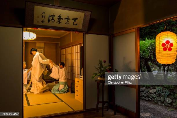Shinto priest Masatsugu Okutani 41 dresses into his ceremonial clothes in preparation for the Summer Grand Purification ceremony to be held at the...