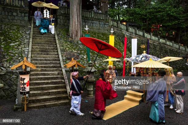 Shinto priest Masatsugu Okutani 41 together with his father Kazufumi Okutani 71 conduct the Summer Festival starting in Yabuhara sanctuary and...
