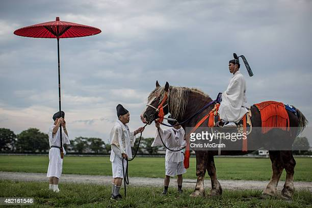 Shinto Priest oversees proceedings during the Soma Nomaoi festival at Hibarigahara field on July 25 2015 in Minamisoma Japan Every summer the people...