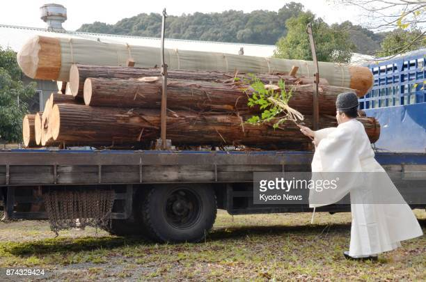 A Shinto priest performs a purification ceremony for logs of Japanese 'hinoki' cypress at the Ise Jingu shrine in Ise Mie Prefecture on Nov 15 2017...