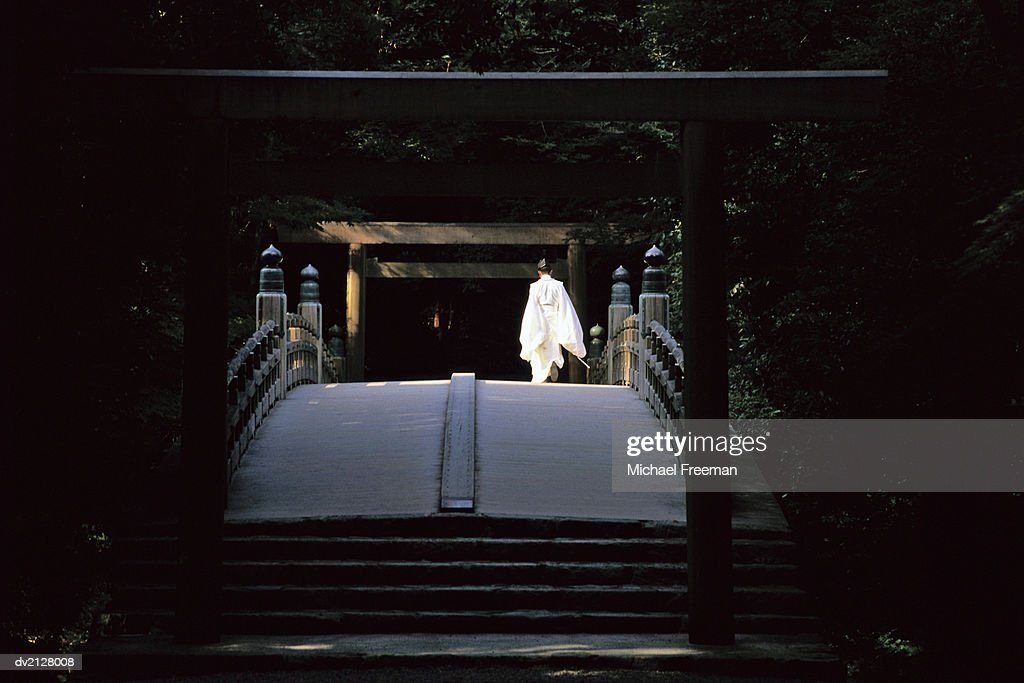 Shinto Priest Walking on a Bridge : Stock Photo