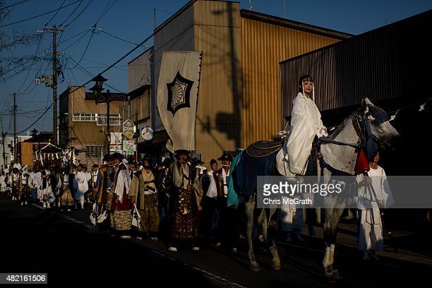 Shinto Priestess rides a horse during a parade to the Nakamura Shrine after the Soma Nomaoi festival on July 26 2015 in Soma Japan Every summer the...