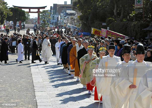 Shinto priests Buddhist monks and Christian bishops attend a memorial ceremony to commemorate the victims of the magnitude 90 earthquake and...