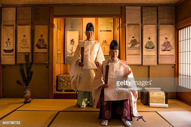 Shinto priests ceremonial dressed with ancestors