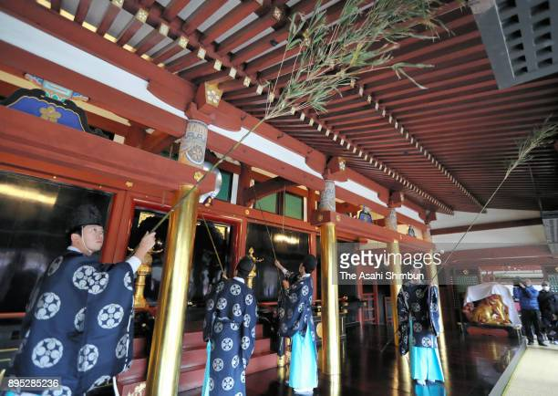 Shinto priests clean with using bamboos during the annual yearend dusting at Dazaifu Tenmangu Shrine on December 19 2017 in Dazaifu Fukuoka Japan