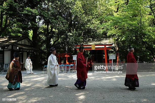 Shinto shrine priest walk to attend ritual ceremony during the Aoi Festival at Shimogamo Shrine on May 152016 in Kyoto Japan Aoi Festival is one of...