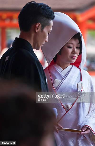 Shinto Wedding Newlyweds at Itsukushima Shrine on Japan's Sacred Miyajima Island