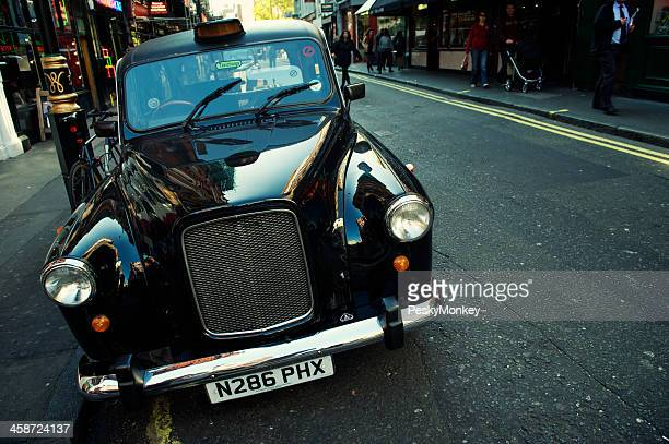 Shiny Black Cab Stands Parked on London Street
