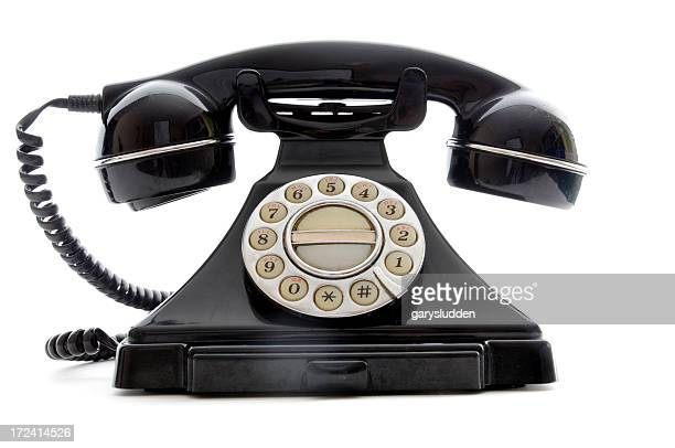 Shiny black retro finger dial telephone on white background