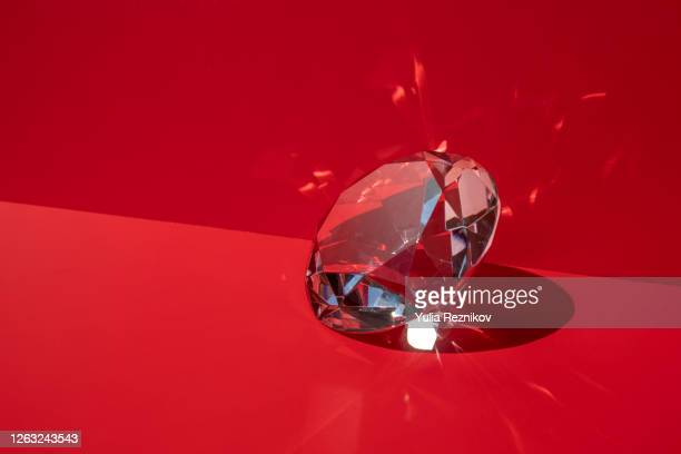 shiny diamond on the red background - diamant stockfoto's en -beelden