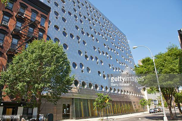 Shiny facade of building with window punch-holes