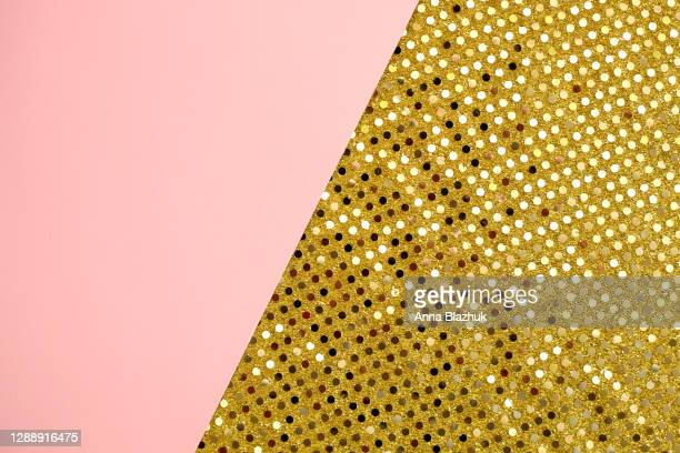 shiny glowing golden fabric. festive abstract pink background for holidays, new year, christmas. - theatrical performance stock pictures, royalty-free photos & images