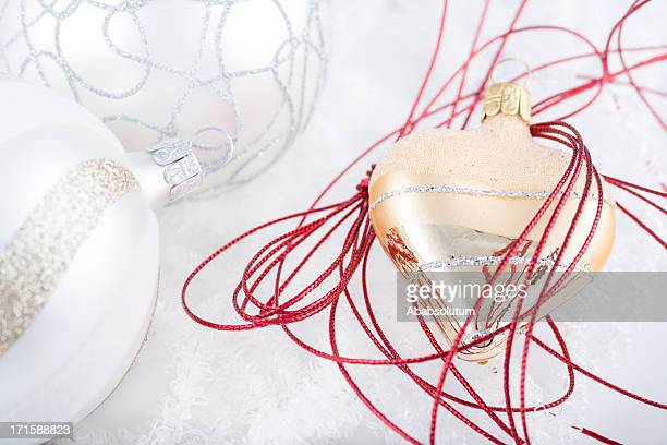 shiny gold heart bauble in red and white balls - heart month stock photos and pictures