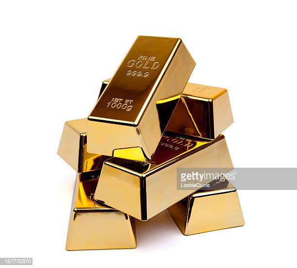 Shiny gold ingots stacked upon each other