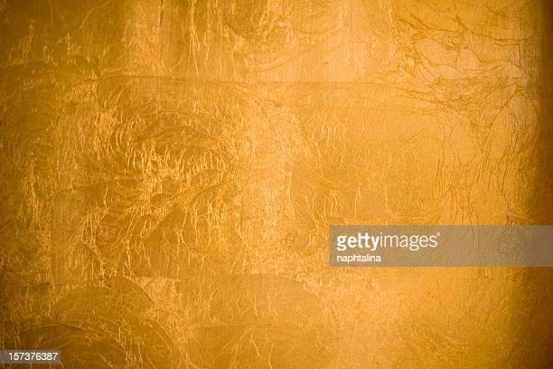 a shiny gold textured background - gold foil stock photos and pictures