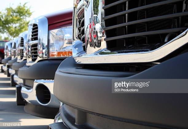 Shiny Grids On Front Of New Trucks At Car Lot