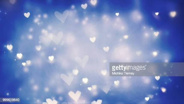 Shiny hearts and abstract lights background