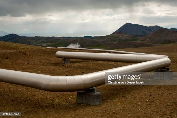 shiny metal tubes in volcano landscape - geology stock pictures, royalty-free photos & images