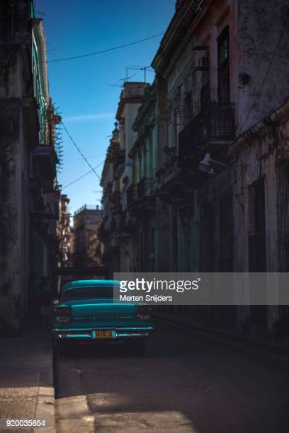 Shiny metallic Pontiac car in Havana alley