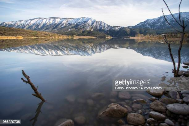 Shiny mountain lake reflecting surrounding landscape, Pobla de Segur, Lleida, Spain