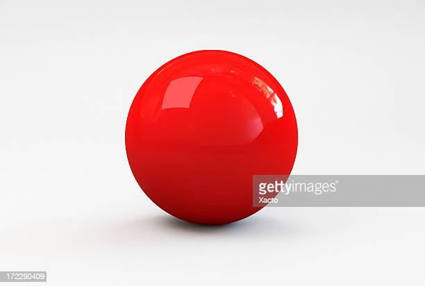 a shiny red ball with shadow on a white background - sports ball stock pictures, royalty-free photos & images
