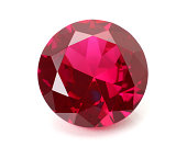 A shiny red ruby gemstone on a white background