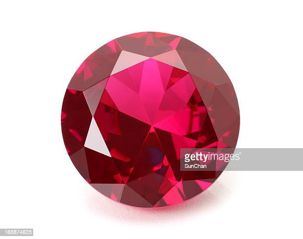 a shiny red ruby gemstone on a white background - gemstone stock pictures, royalty-free photos & images