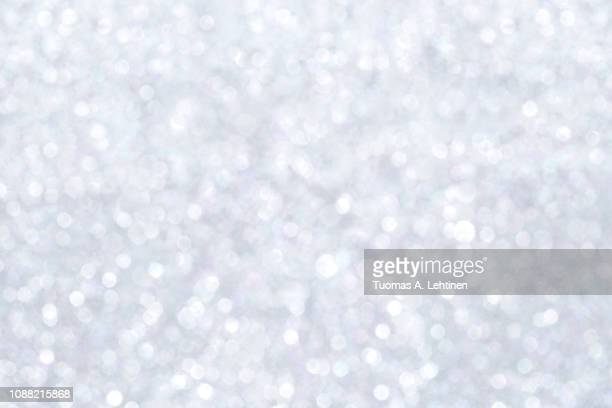 shiny silver bokeh texture background - silver coloured stock pictures, royalty-free photos & images