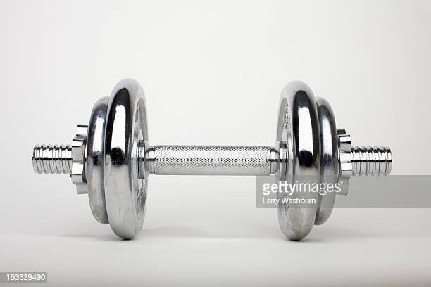 a shiny silver dumbbell - hand weight stock pictures, royalty-free photos & images