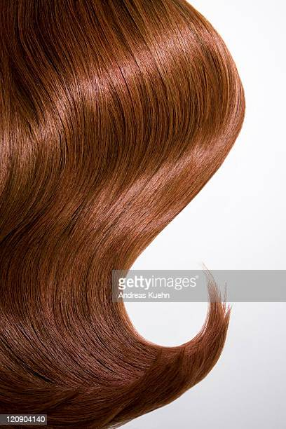 shiny wavy red hair on white background, cropped. - cabelo castanho - fotografias e filmes do acervo