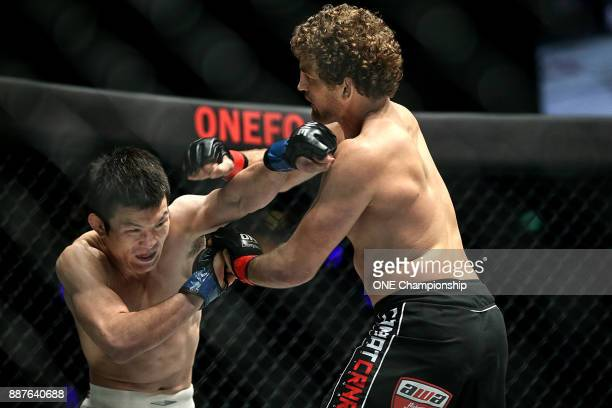 Shinya Aoki throws a punch at Ben Askren during ONE Championship Immortal Pursuit at the Singapore Indoor Stadium on November 24 2017 in Singapore...
